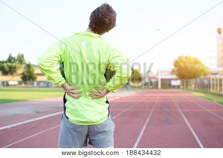 Sportsman feeling backache because of over training