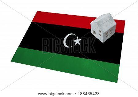 Small House On A Flag - Libya