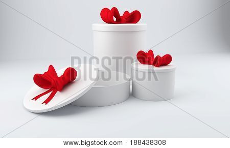 Three blank 3D round gift boxes with red bow over gray background. 3D rendering.