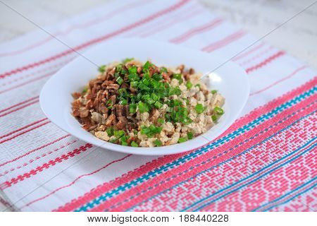 Chicken Forcemeat With Mushrooms And Greens On A Plate On A Light Background