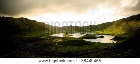 Landscape sunset view to Caldeirao crater at Corvo island Azores Portugal