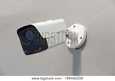 Wireless surveillance camera on the wall of the building