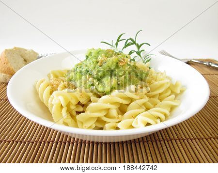 Pasta with zucchini sauce and breadcrumbs on plate