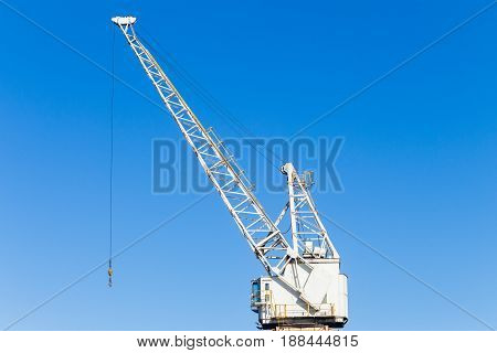 Crane mechanical pulleys cables for hoisting rigging ships cargo repairs maintenance harbor infrastructure machines.