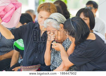 CHIANG RAI THAILAND - APRIL 19 : unidentified asian old woman crying in thai traditional Christian funeral on April 19 2017 in Chiang rai Thailand.