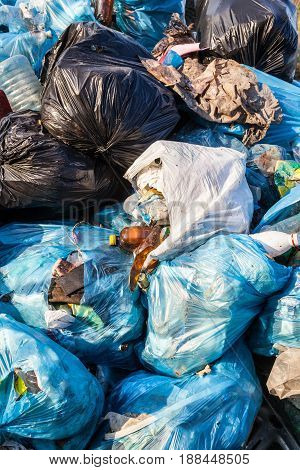 Piles of garbage in plastic bin (trash waste) bags. Landfill. Close-up.