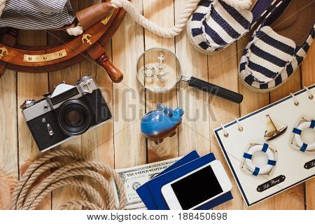 Striped Slippers, Piggy Bank, Phone And Maritime Decorations, Wooden Background