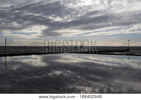 Reflection of clouds in the water at Leigh-on-Sea near Southend Essex England