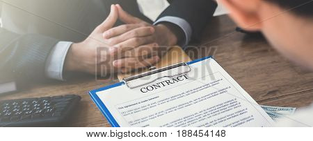 Business partners making agreement with hidden money on the table - bribery corruption and loan concepts web banner