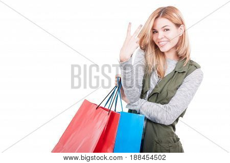 Young Female In Casual Clothes Carrying Shopping Bags