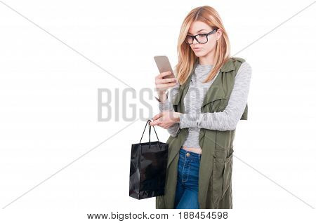 Young Woman Texting While Carrying Shopping Bag