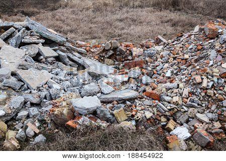 Pile of broken bricks and concrete blocks. Construction debris.