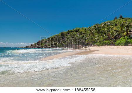 Beautiful sea surf on a beach in tropical island.