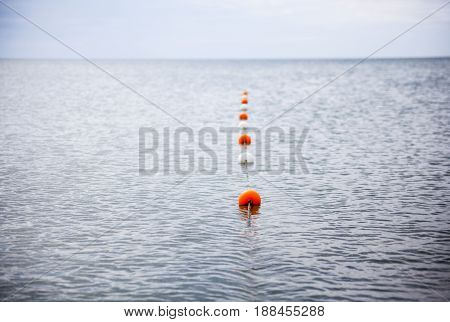 Safety rope and float line in the sea.