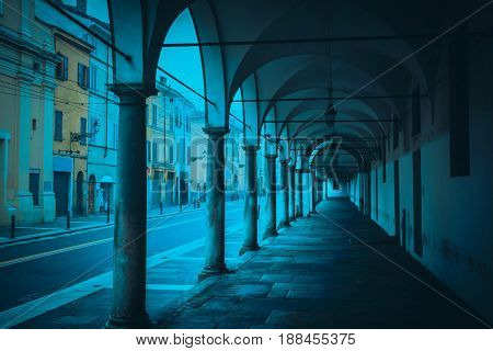 Old colonnade and street in Parma Emilia-Romagna Italy.