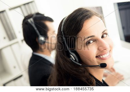 Business woman working in call center as an operator telemarketer or customer service staff