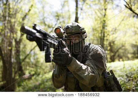 Russian soldier with submachine gun in forest on combat mission
