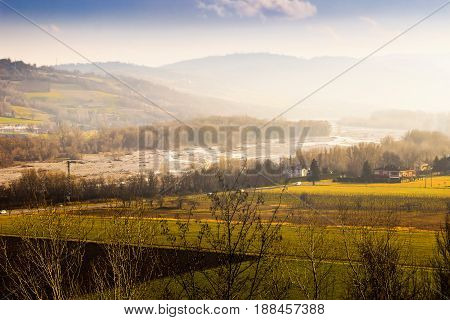 Scenic Lanscape With Hills At Sunset