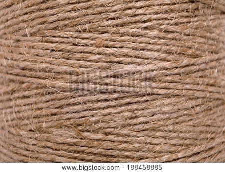 Natural jute twine texture. Close up of twisted rope, handmade or gardening background