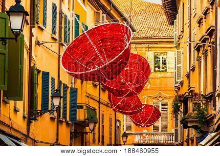 Red Umbrellas Hanging On Old Street