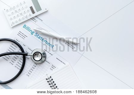 stethoscope, billing statement for doctor's work in medical center on white background top view space for text