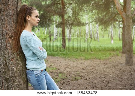 Young Woman Enjoying Her Time Outside In Park