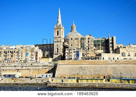 VALLETTA, MALTA - MARCH 30, 2017 - View of St Pauls Anglican Cathedral and the Basilica of Our Lady of Mount Carmel Valletta Malta Europe, March 30, 2017.
