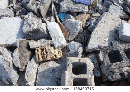 Broken concrete blocks and bricks. Construction debris.