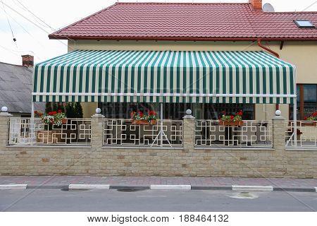 Modern cafe with outdoor terrace in Ukrainian Schodnica