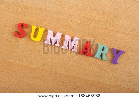 SUMMARY word on wooden background composed from colorful abc alphabet block wooden letters, copy space for ad text. Learning english concept