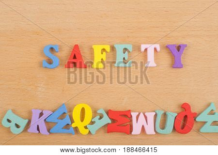 SAFETY word on wooden background composed from colorful abc alphabet block wooden letters, copy space for ad text. Learning english concept