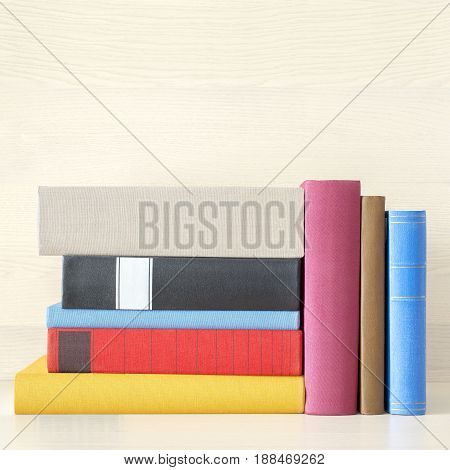 stack of new colorful books in the bookself