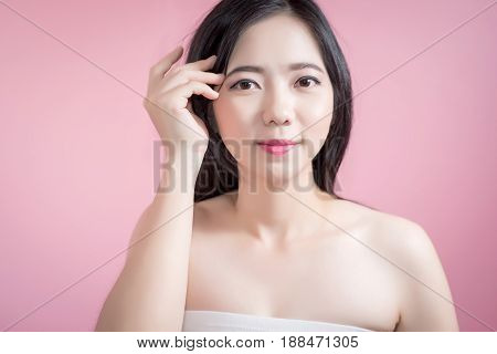 Long Hair Asian Young Beautiful Woman Cross Arm And Point Finger Upward Isolated Over Pink Backgroun