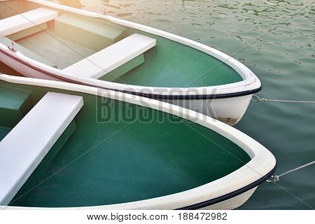 White rowboat moored near shore. Concept - boat, quiet, wait, life, hope