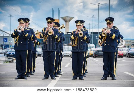 Brasov, Romania - 28 May 2017: Romanian National fanfare singing outdoors with the occasion of aeronautical show and presentation of old planes
