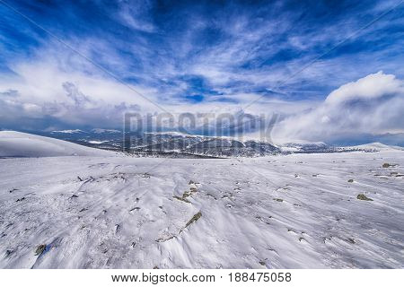 a gentle mountain range in the winter time
