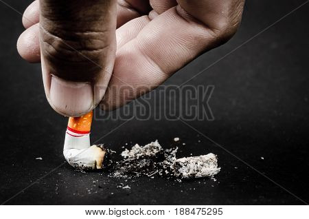 Close up the man hand holding cigarette