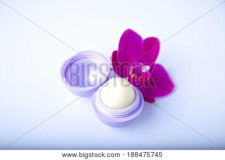 Lip balm with  terra-cotta color flower. Lip care