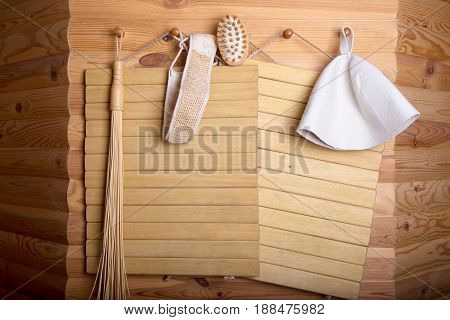Wooden wall of the sauna accessories. Healthy time