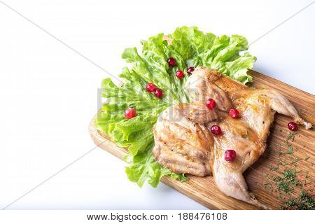 Roasted Quail with  cowberry   on a white