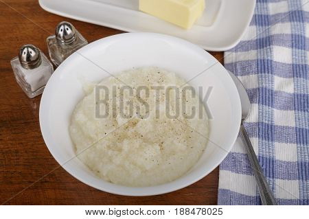 A bowl of hot tasty grits with butter