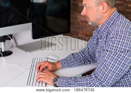 Senior Man Working In The Office