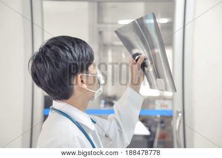Asia Scientist Work In White Tone.