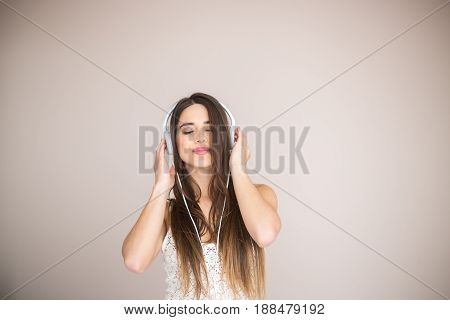 Young Woman Listening Music And Enjoy Isolated