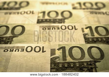abstract unsharp background a collage from money and currency or from paper banknotes in hundred euros closeup in retro style