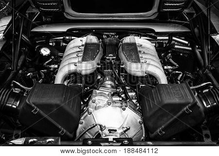 BERLIN GERMANY - MAY 17 2014: Engine of a sports car Ferrari Testarossa (Type F110). Black and white. 27th Oldtimer Day Berlin - Brandenburg