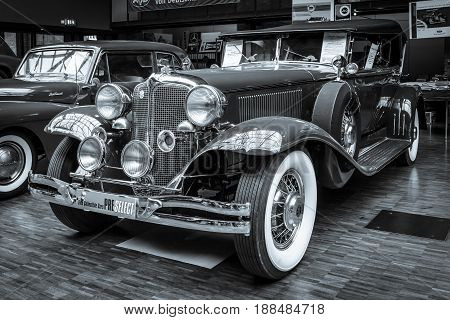 BERLIN GERMANY - MAY 17 2014: Oldtimer Chrysler Imperial Series CG-Eight 4-Door Dual Crawl Phaeton (1931). Black and white. 27th Oldtimer Day Berlin - Brandenburg