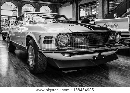 BERLIN GERMANY - MAY 17 2014: Ford Mustang Mach 1 428 cu in (7.0 L) Ramair Cobra Jet - is an performance-oriented option package of the Ford Mustang. Black and white. 27th Oldtimer Day Berlin - Brandenburg