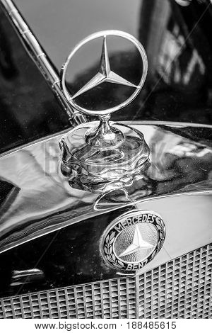BERLIN GERMANY - MAY 17 2014: Hood ornament of the mid-size luxury car Mercedes-Benz W21. Close up. Black and white. 27th Oldtimer Day Berlin - Brandenburg