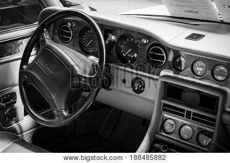 BERLIN GERMANY - MAY 17 2014: Interior of the driver's seat of the car Rolls-Royce Corniche IV. Black and white. 27th Oldtimer Day Berlin - Brandenburg